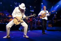 Carlos Santana and John McLaughlin at the Montreux Jazz Festival. Photo via Reuters
