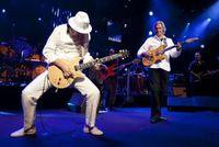 Carlos Santana and John McLaughlin at the Montreux Jazz Festival. Photo via Reuters